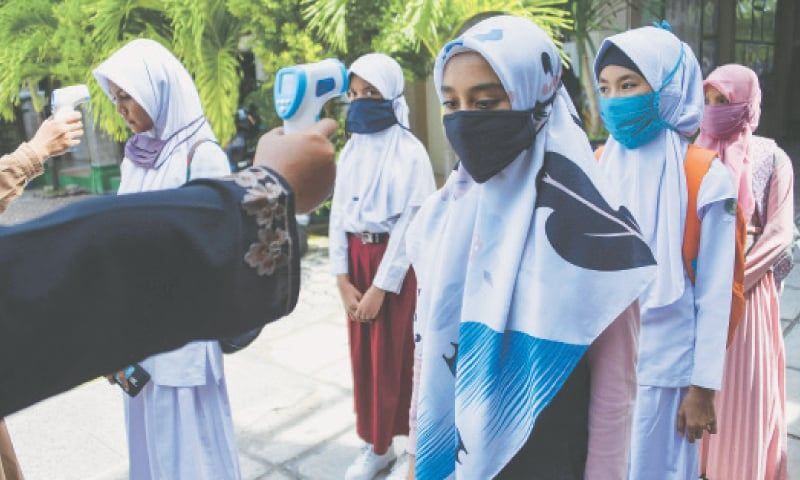 INDONESIA bans mandatory Islamic 'hijab' scarves for schoolgirls